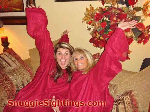 Ange and Mom enjoying a round of Snuggie Couch Show Tunes, complete with Jazz Hands and Winning Smiles.