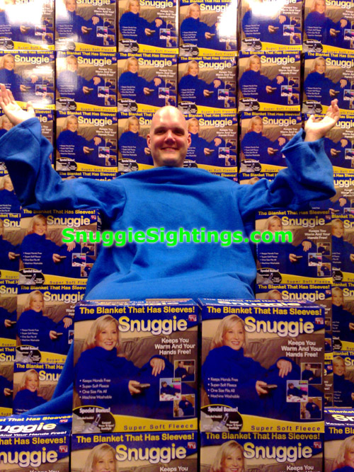 The Snuggie Collector - Scott sits on his Snuggie Mountain...all in Mint Condish. 3 Sherpas died last week trying to summit K-Snuggie. Scott is currently writing a book about the tragedy, entitled \'Into Thin Snuggie\'.