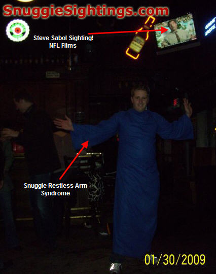 Heath menacing pub patrons in his Snuggie.