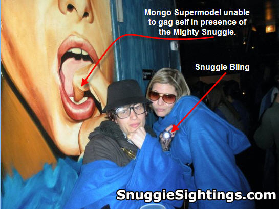 Jordan and Emily strike a Snuggie Pose - Emily's bling ring blinds the cameraman while the stunned wall art looks on.