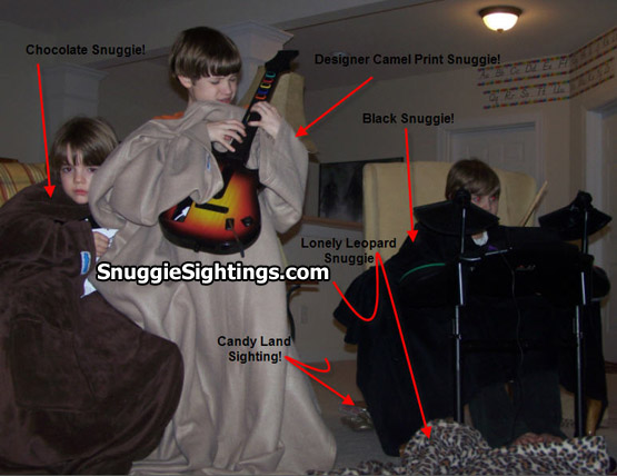 Eight-finger tappin' in a Designer Camel Snuggie. Note the Designer Leopard Snuggie just laying there.