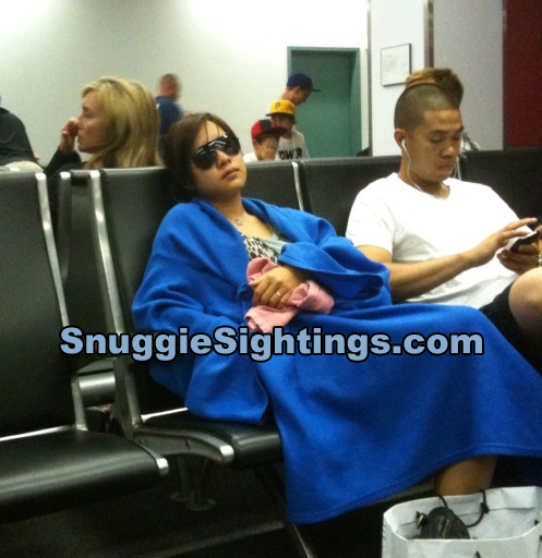 Shouldn't all blankets on planes be Snuggies?