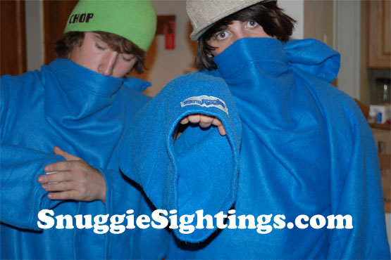 Nothing up my sleeve...but get too close and I'll tatoo your forehead with this Snuggie logo!