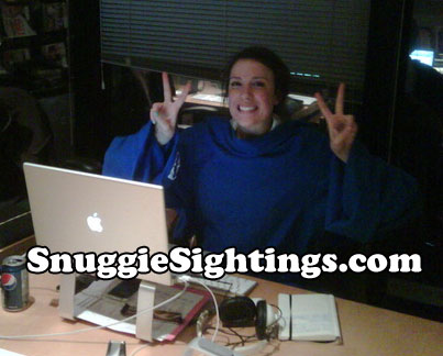 When is the last time you smiled this big at work? Snuggie boosts office morale while lowering heating bills. Win Win.