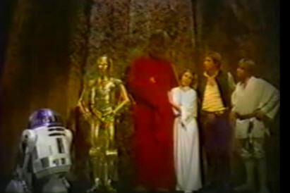 Intergalactic Snuggie Sighting - The Red Snuggie is a chick magnet. Harrison Ford loses out to a Wookiee.