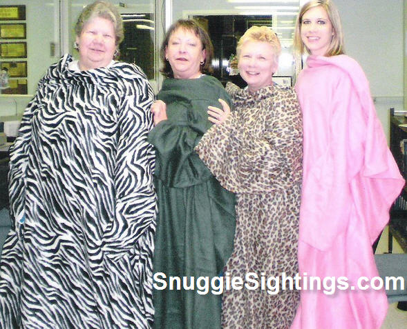This Snuggie Quartet answers with an emphatic 'Yes' when asked if it is ok to wear the Snuggie at the office.