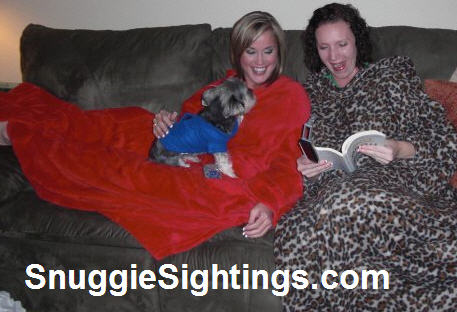 I don t know if it is the fleecy goodness of the Snuggie or this booklight.  Either way 7e5452d8e